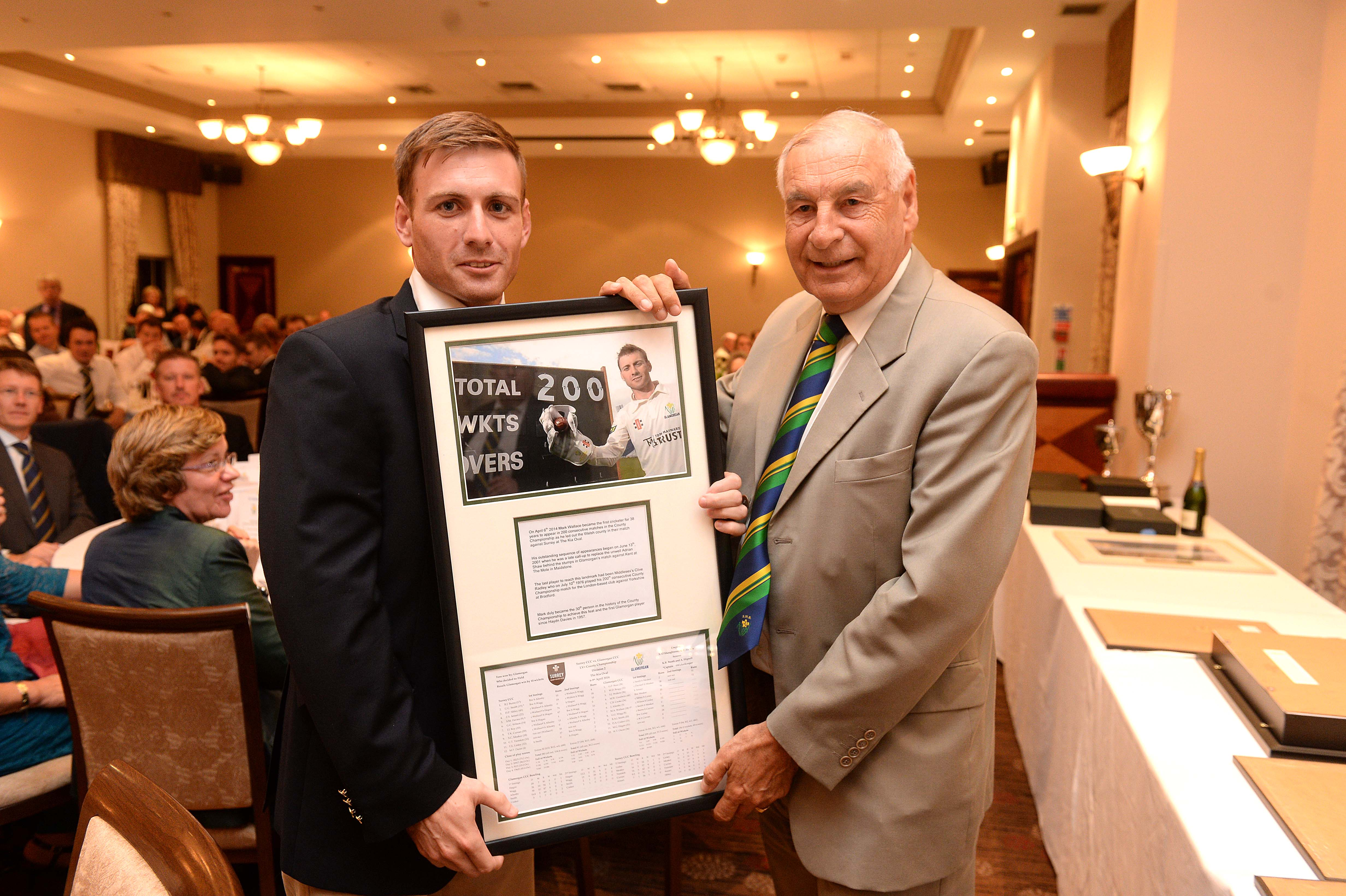Wicketkeeper Mark Wallace receives a Special Award from Balconiers' Treasurer Clive Hemp to mark 200 consecutive County Championship appearances fro Glamorgan.